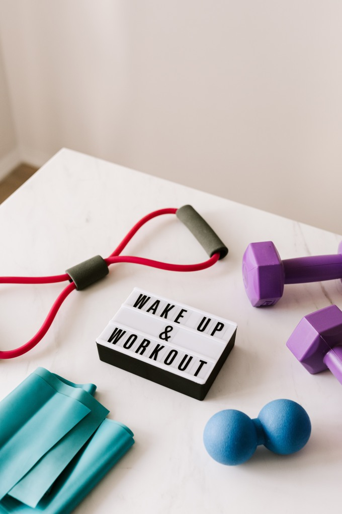 wake-up-and-workout-slogan-on-light-box-among-sports-4397840